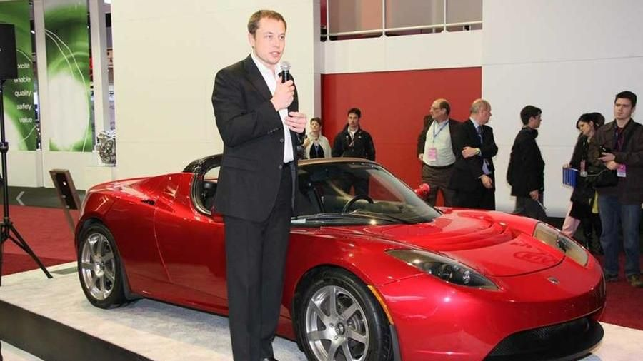 A young Elon Musk with the 2008 Tesla Roadster built on a Lotus basis