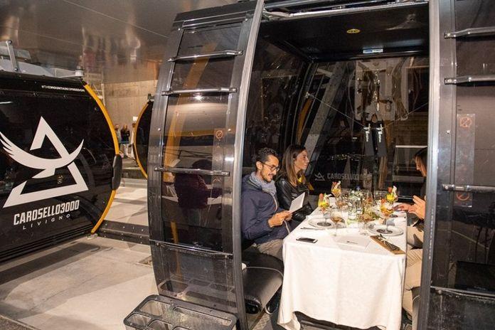 Livigno, spettacolo sulla cabinovia: la cena gourmet è ...