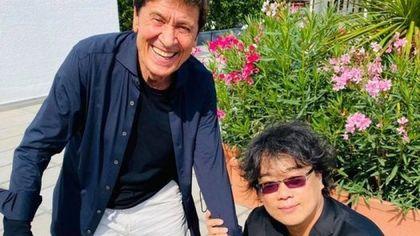 "Venezia 78. Gianni Morandi incontra Bong Joon-ho: ""Mi sono emozionato"""