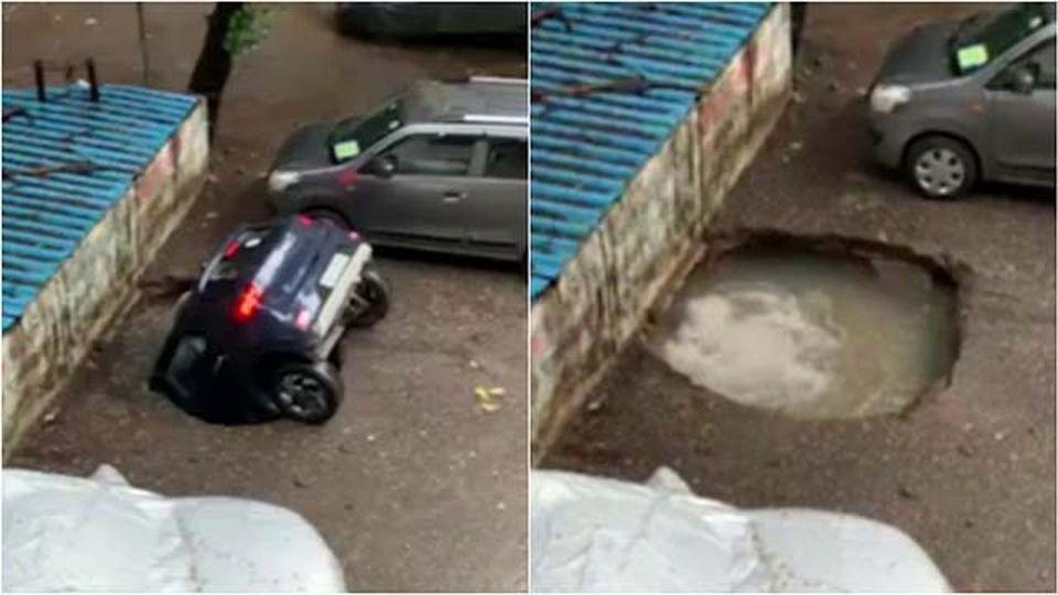 India, violenti temporali a Mumbai: l'auto viene inghiottita dalla voragine